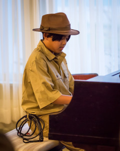 "Dylan, dressed as Indiana Jones, playing ""The Raider's March"""